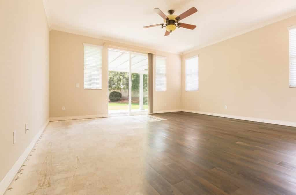 Room with Gradation from Cement Floors to Hardwood Flooring Inst