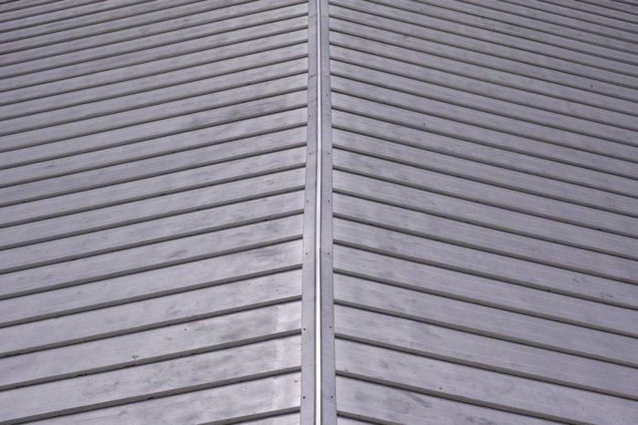 Secure the corrugated metal roof panels