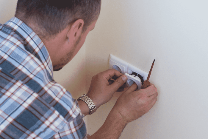 Electrician installing