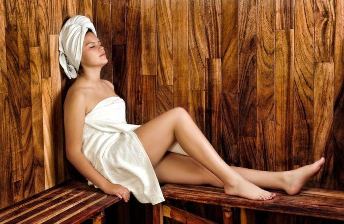 lady relaxing in sauna