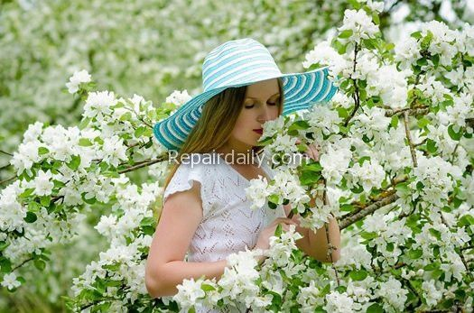 lady smelling flowers