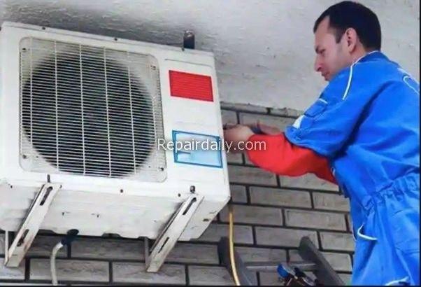 man repairing air conditioner