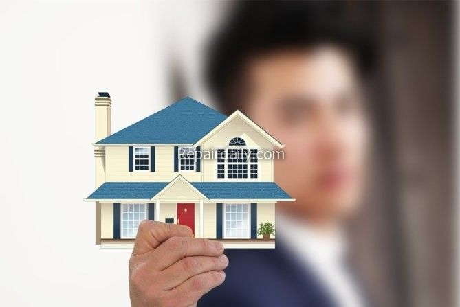 man showing small house