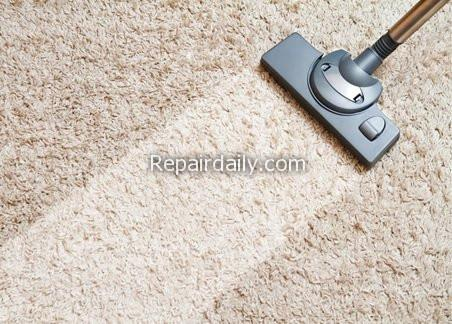 vacuum cleaner cleaning carpet