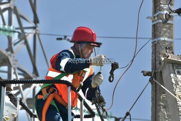 electrician at electricity energy pole