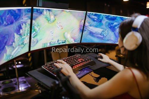 lady gamer playing computer game
