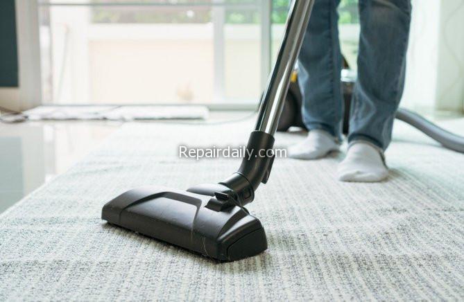 man using vaccuum cleaner