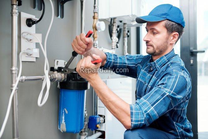 plumber working on plumbing