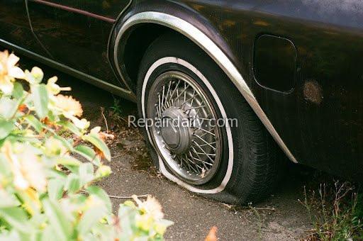 car punctured tire